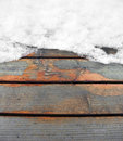 Partly snow covered wooden boards rundown Royalty Free Stock Image