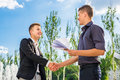 Partner shaking hands two happy successful business outdoor Stock Photo