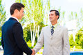 Partner shaking hands two happy successful business outdoor Stock Images