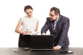 Partners conduct negotiations facing a table and look at the laptop Royalty Free Stock Image