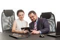 Partners conduct negotiations sitting at a table and look at the tablet Stock Photo