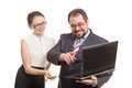 Partners conduct negotiations standing and look at the laptop Stock Photo