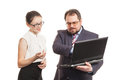 Partners conduct negotiations standing and look at the laptop Stock Photography