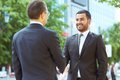 Partners satisfied shaking hands in the urban surroundings Stock Photo