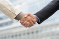 Partnership close up of male handshaking outside Stock Photo