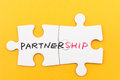 Partnership concept word written on two pieces of white paper jigsaw puzzles Stock Image