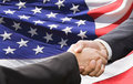 Partnership and politics concept handshake over american national flag background Stock Photography