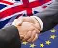 Partnership and politics concept handshake over eu british flag Stock Photo