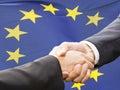 Partnership and politics concept handshake over eu flag Royalty Free Stock Photo