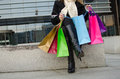 Parts of body of young woman with shopping bags in black in vilnius lithuania Royalty Free Stock Photography