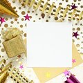 Party background with gift box, gold and purple confetti, serpentine and empty paper for text Royalty Free Stock Photo