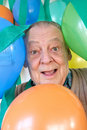 Party balloons & elderly man Royalty Free Stock Photography
