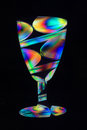 Party beaker spoons consisting transparent plastic seen polarized light composed together oin front black background Royalty Free Stock Images