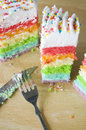 Party cake pieces of rainbow with fork and knife Royalty Free Stock Photo