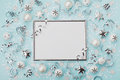Party carnival christmas background decorated silver frame with confetti, balls and star on turquoise desk top view. Flat lay. Royalty Free Stock Photo