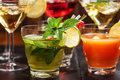 Party cocktails and longdrinks for summer garnished with fruits Stock Photography