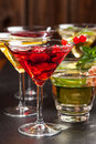 Party cocktails and longdrinks for summer garnished with fruits Stock Images