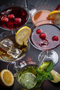 Party cocktails and longdrinks for summer garnished with fruits Royalty Free Stock Photos