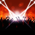 Party crowd dancing under the lights and music Stock Image