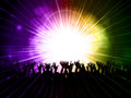 Party crowd on purple and green background with laser lights Royalty Free Stock Image