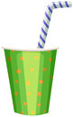 Party cup with striped straw Royalty Free Stock Photo
