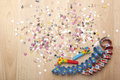 Party decoration for parties streamers and confetti as sylvester with white background Stock Photo