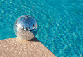 Party! Disco Ball beside resort swimming pool Royalty Free Stock Photo