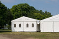 A party or event tent white on meadow in public park Stock Images