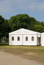 A party or event tent white on meadow in public park Stock Photo