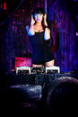 Party in garage beautiful sexual dj girl working on a the old Royalty Free Stock Photos