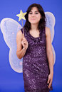 Party girl young beautiful woman dressed as tinkerbell studio picture Stock Photo