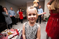 Party goers on new year x s eve young girl standing with adult at home Royalty Free Stock Images