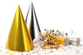 Party hats and paper streamer confetti on white background Royalty Free Stock Photo