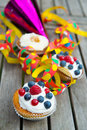 Party muffins with blow out on wooden board Stock Photography