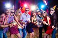 Party at nightclub cheerful young company celebrates in a Royalty Free Stock Photos