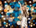 Happy young woman dancing over party lights Royalty Free Stock Photo