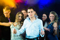 Party people dancing in disco club young or and have the girls and boys friends having fun Stock Photography