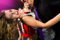 Party people dancing in disco club young or and have the girls and boys friends having fun Royalty Free Stock Image