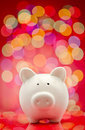 Party piggy bank with lights background Royalty Free Stock Photo