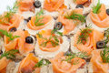 Party platter of bite size smoked salmon appetisers canapes Stock Image