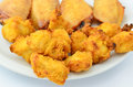 Party snacks meaty of bite size chicken bits and chicken wings Stock Images