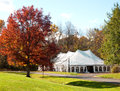 Party tent set up in an autumn park Stock Images
