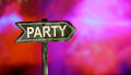 Party text white paint on colorful sweet bokeh background. Royalty Free Stock Photo