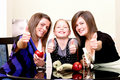 Party. Three cheerful girls. Royalty Free Stock Photography