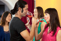 Party time drinking rose wine at a gathering with friends Stock Image