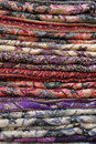 Pashmina scarves pile of for sale in a fashion shop Royalty Free Stock Images