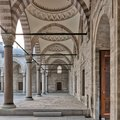 Passage leading to Sulaymaniye mosque, with columns, arches and marble floor, Fatih district, Istanbul, Turkey Royalty Free Stock Photo