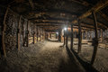 Passage through old coal mine in wall and ceiling reinforcement infrastructure visible Royalty Free Stock Image