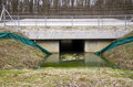 Passageway for the animal under highway full of water Royalty Free Stock Photography