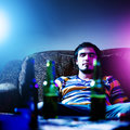 Passed out drunk young man by himself Stock Photography